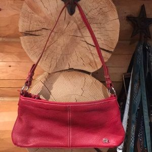 The Sak small red leather purse w/shoulder strap.